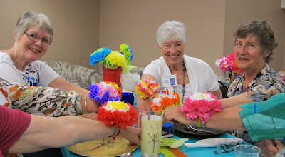 Photo: Grannies Annette, Anne and Linda enjoy the handcrafted blooms.