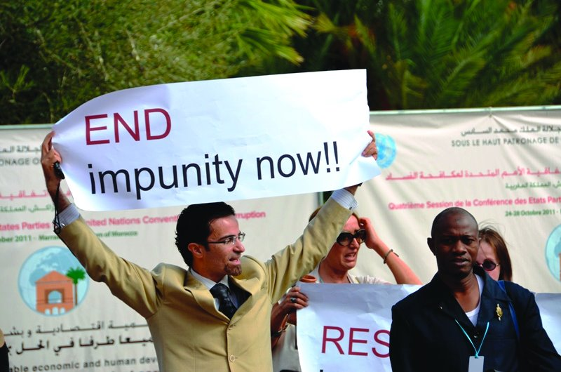 Photo: A demonstration of UNCAC coalition members calls on leaders to end impunity. © Transparency International