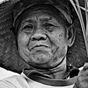 Tired smile grandmother by Widia Widana - People Portraits of Women