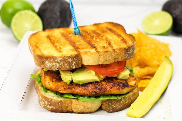 Assembled Grilled Chicken Sandwich With Cilantro Lime Mayo.