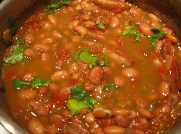 Once beans are almost tender (after about an hour) remove the jalapeno, add the...