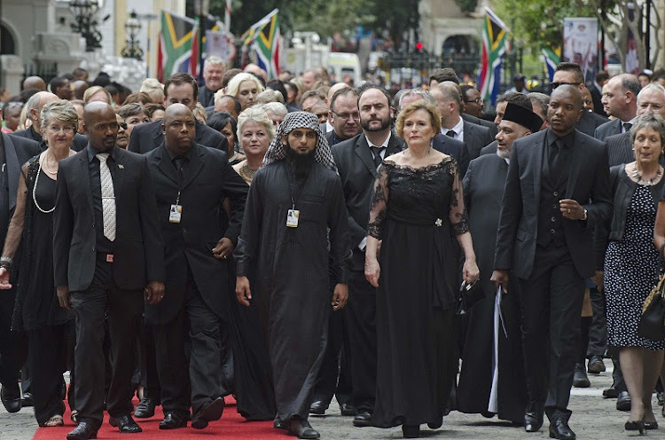 Clad in black, members of the Democratic Alliance including party leader Helen Zille (second from right) and parliamentary leader Mmusi Maimane (far right) arrive for the state of the nation address. Picture: TREVOR SAMSON