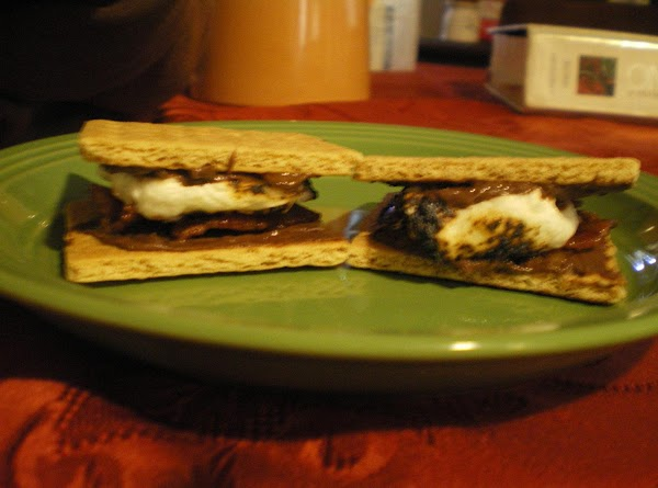 Top bottom crackers (that have bacon on them) with cooked marshmallow and then last...