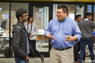 Photo: Dave Thomas talking with Jerry Huang, Senior Program Director, UChicago Careers In Entrepreneurship