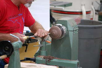 Photo: He shapes the jam chuck so that he can turn the bowl around and finish turning the bottom.
