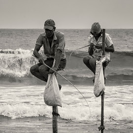 Sri Lankan stilt fisherman by Girish . - Black & White Portraits & People ( canon, fishermen, stilt, black and white, waves, sea, fishing, beach, sri lanka, fisherman )