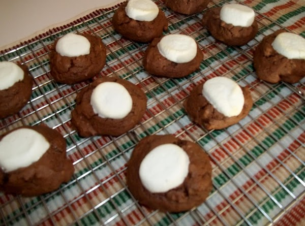 Bake for 6 minutes.Press a marshmallow half, cut side down, onto each cookie. Bake...