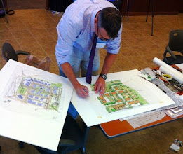 Photo: Landscape architect Chad Brintnall works on the final proposed plan.