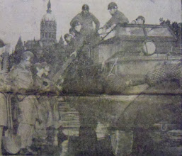 """Photo: Soldiers leave Hartford with a """"duck"""" - an amphibious tank - to bring supplies to Winsted."""