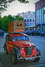 Photo: Old Soviet Era automobile finds new use as a rolling billboard.
