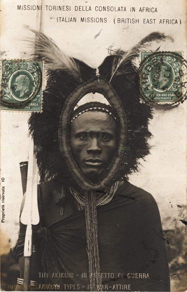 """=[PE06B1]= Akikuyu types - in war attire - Dated 1905 -  BY: Italian Missions (British East Africa) -1900s - <a href=http://www.oldeastafricapostcards.com/wp-content/uploads/2014/02/PE06B1v.jpg """" target=""""_blank"""">Verso</a>"""