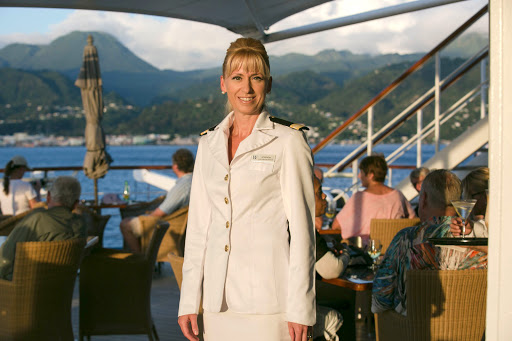 Amanda-Millar.jpg - Amanda Millar, the congenial guest services director on Wind Surf, at sunset with St. Barts in the background.