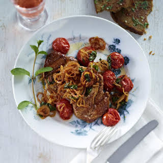 Pork Steaks with Tomatoes, Fried Onions and Garlic Bread.