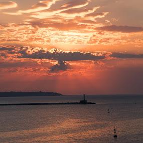 Sunrise over the Bay  by Stoyan Baev - Landscapes Sunsets & Sunrises ( clouds, lighthouse, horizon, sea, seascape, sunrise, sun )