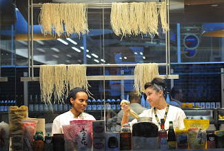 Photo: Executive chef, Sara Johannes, right makes raman noodles as prep cook Damenech Butaker, left,  assists at the new Japanese Restaurant, Shoyu located on Concourse G at the Minneapolis St. Paul airport on September 5, 2012. The chefs can be seen working behind glass as travelers pass by on the way to catch their flight. (Pioneer Press: Ginger Pinson)