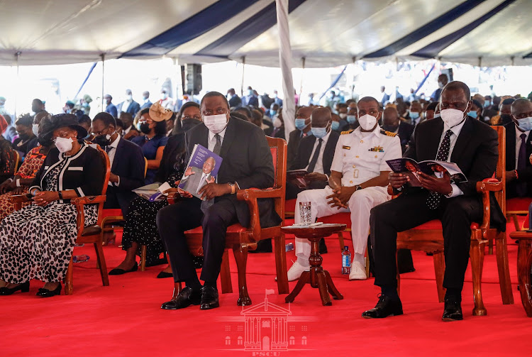 President Uhuru Kenyatta, Deputy President William Ruto join other mourners at the funeral service of former Cabinet Minister Simeon Nyachae at Gusii Stadium in Kisii County on February 15, 2021.