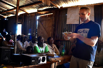Photo: Will introduction giving an introduciton to community currency in Kawangware - at Nyendo sponsored schools
