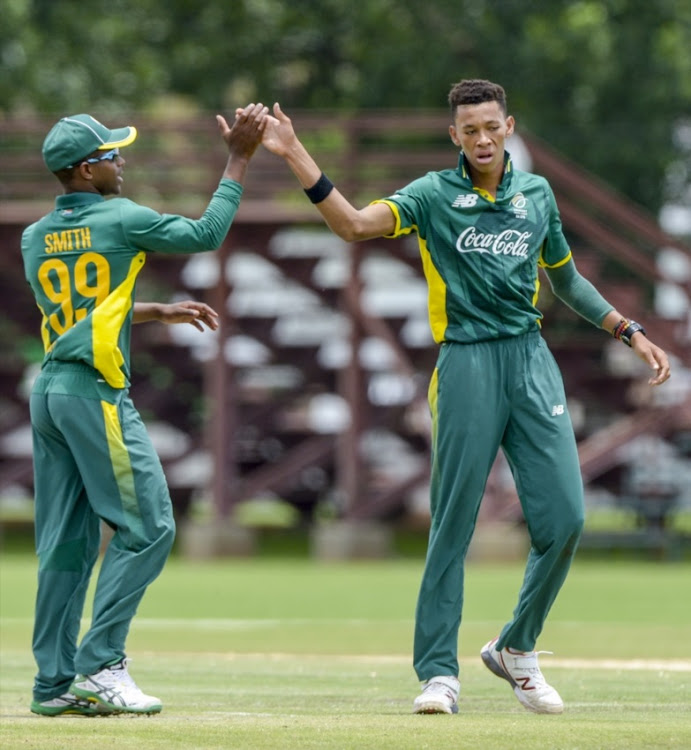 Thando Ntini, right, of South Africa celebrates with teammates during the U/19 Tri Series match between South Africa and Namibia.