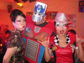 Photo: China Girl, Optimus Prime & a Race Queen at Ola Tacos Bar, in Shinsaibashi, Osaka  Taken at Ola Tacos Bar (http://homepage2.nifty.com/olatacos/) Taken by Be & Me (http://www2.gol.com/users/be-n-me/)