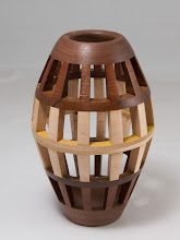 "Photo: Bob Grudberg 3 1/2"" x 7"" open segmented form [walnut, maple]"