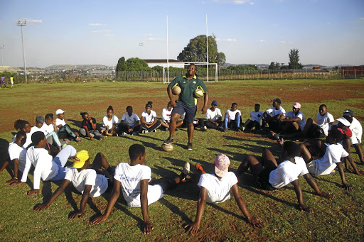 A group of girls from Letsibogo Girls High School have formed a rugby team. They practice on an open soccer field./KABELO MOKOENA