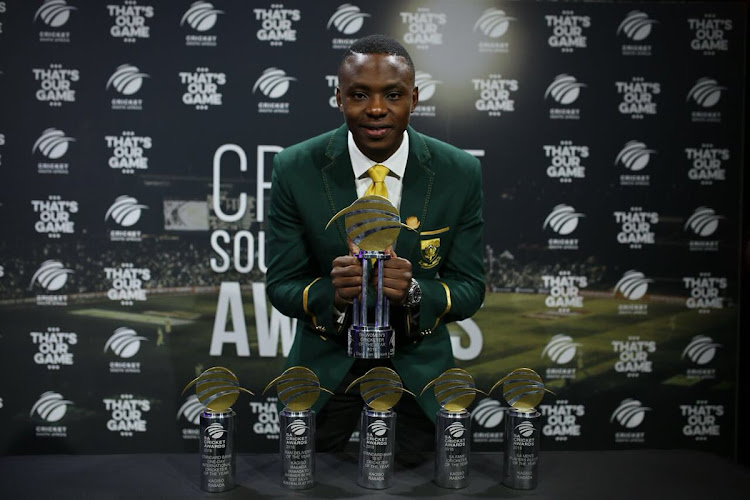 SA Cricketer of the Year Kagiso Rabada poses for photographs with his trophies.