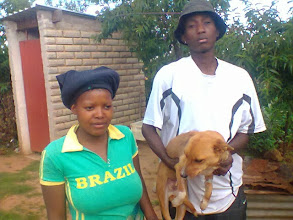 Photo: Themba our trusty assistant returning the dog to his owner