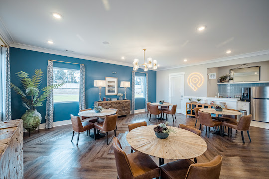 Clubhouse with dining tables and coffee bar