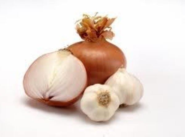 Place vinegar, onion and garlic in a blender or food processor and puree