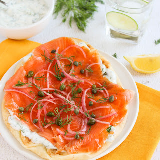 Nann Bread Smoked Salmon Pizza with Dill Sauce and Pickled Onions.