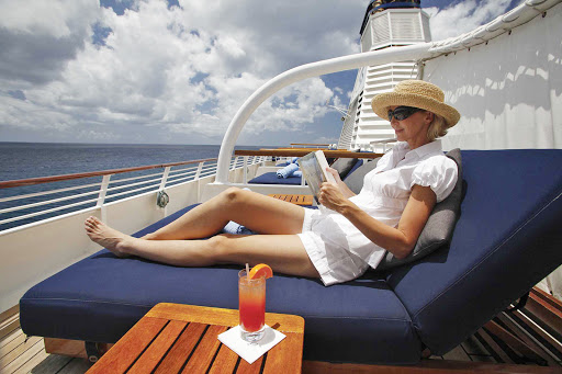 Seadream-read-relax.jpg - Sea days on a SeaDream cruise allow you to take a little time for yourself.