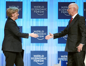 Photo: DAVOS/SWITZERLAND, 25JAN12 - Angela Merkel (L), Federal Chancellor of Germany and Klaus Schwab, Founder and Executive Chairman, World Economic Forum greet each other at the beginning of the session 'Opening of the Annual Meeting 2012' at the Annual Meeting 2012 of the World Economic Forum at the congress centre in Davos, Switzerland, January 25, 2012.  Copyright by World Economic Forum swiss-image.ch/Photo by Sebastian Derungs