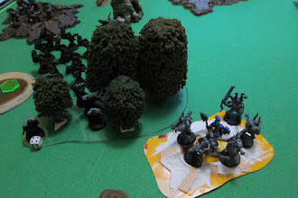 Photo: Turn 1 - end of Dark Angel turn - the Chaos Rhino explodes, forcing the Khorne Berzerkers within to huddle for cover in the smoking ruins of their Rhino! (we forgot to roll for explosion distance)