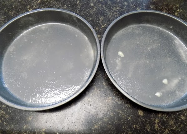 Grease sides and bottom of 8-inch round cake pans with cooking spray. Flour lightly.