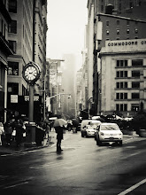 "Photo: ""Romance...""  There is an inherent romance that buzzes through the air in New York City when it rains.  The Flatiron District is one of my favorite areas in Manhattan when it rains. The street (5th Avenue) opens up to reveal distant skyscrapers that disappear into heavy fog as people weave their way through the multitudes of umbrellas.  The clock in this image is the Fifth Avenue Building Clock (a close-up image of and its history is in this post) which is a New York City landmark and recalls another era: one where these ornamental clocks played a role in attracting people to gilded era storefronts. This vantage point is with the Flatiron Building directly in back of the viewer looking up 5th Avenue.  —-  I have had quite a few requests that I add some of my New York City mobile photography to my online store and portfolio (here: http://goo.gl/FusmD ) since people are looking to buy holiday gifts. This is the first of one of those requests. It was taken with my phone and has been lovingly added (here: http://goo.gl/FyDo0 ).  —-  New York Photography: 5th Avenue in the rain in midtown Manhattan    You can view this post along with all relevant links at my site here:  http://nythroughthelens.com/post/36599075646/new-york-city-in-the-rain-flatiron-district    Tags: #photography   #newyorkcity   #nyc   #newyorkcityphotography   #blackandwhite   #blackandwhitephotography   #mobilephotography   #mobileography   #mobilephotographymonday   #iphonography   #iphoneography   #nycmobilephotography   #streetphotography   #newyorkcitystreet   #nycstreet   #nycrain   #rain   #newyorkcityrain   #newyorkrain"