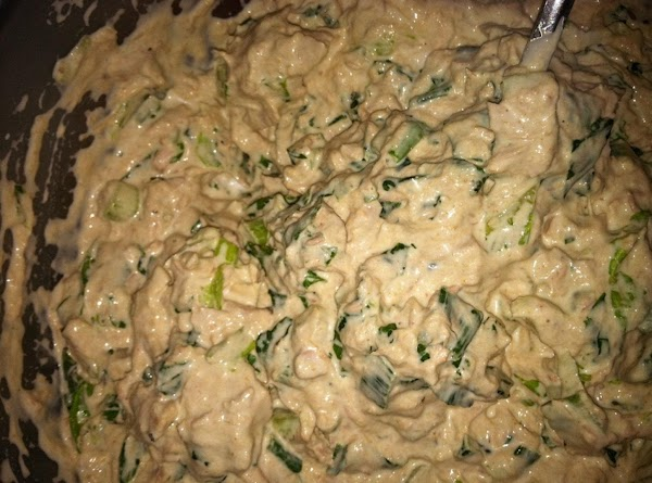 Chop up the veggies and put into a bowl.  Add drained tuna, Emeril's...