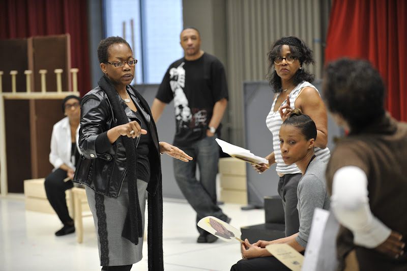 Photo: Playwright and Director Regina Taylor speaks with the cast during rehearsal for her 10th anniversary production of Crowns at Goodman Theatre (June 30 – August 5).