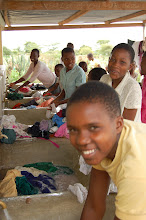 Photo: Ghati Daudi and other children are washing clothes