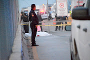 Police officers keep watch at the crime scene where a Mexican asylum-seeker slit his own throat after being denied entry into the United States, at the Pharr-Reynosa International Bridge between the Mexican border city of Reynosa and Pharr, Texas, as pictured in Reynosa, Mexico, on January 8 2020.