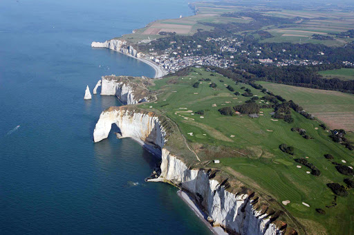 The dramatic chalk cliffs of d'Etretat in Normandy, France, offer some stellar golfing.