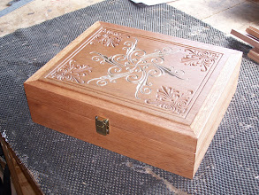 Photo: Low profile handcrafted wooden box in the hardwood red meranti with fairly heavily machine-engraved lid. Central pattern (comprising 6 rotated copies of a simple vector pattern) lightly-highlighted with gold spray paint to provide a contrast to the non-highlighted outer border.
