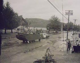 """Photo: An Army """"duck"""" brings supplies to flood-ravaged Torrington."""