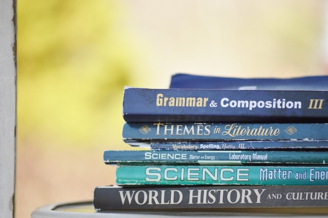 stack of school textbooks representing movies set in school