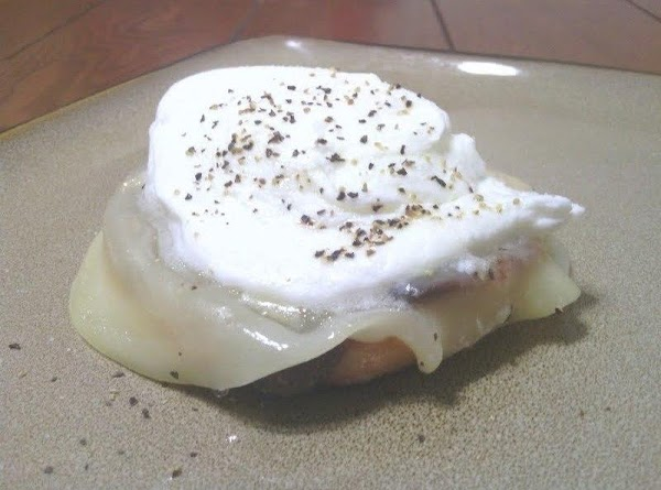 Toast and butter your English muffin, add the slice of provolone, top with the...