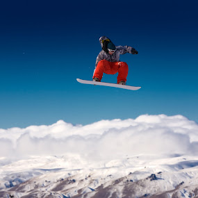 Snowboarder jumping in air by Ben Heys - Sports & Fitness Snow Sports ( ride, skiing, boarder, mountain, travel, landscape, alpine, sky, riding, snow, skyscape, snowboarder, snowboard, ski, extreme, speed, white, sport, fun, board, skier, jump, lifestye, holiday, vacation, blue, cloud, air, high, snowboarding )