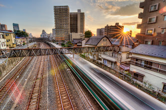 Photo: A sunset in Matsudo over a passing train