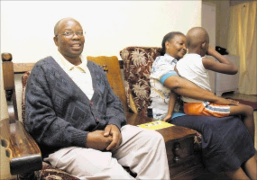 20100323VNH. George Masopha with his wife Emma and their 6-year-old grandson whose mother was murdered by her boyfriend in Kagiso.PIC:VELI NHLAPO.23/03/2010. © SOWETAN