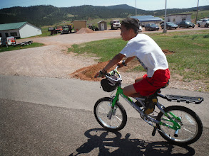 Photo: Day 23 Lusk WY to Hot Springs SD 93 miles, 2300' climbing: Pierce showing us some tricks