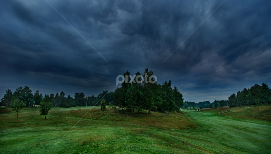 Stormy sky over the golfcourse  by Stefan Johansson - Sports & Fitness Golf ( golfcourse, a77, angry, storm, course, tranquil, sky, nature, tree, interest, dark, golf, august, rain, clouds, thunder, hill, hdr, 2013, grass, green, hobby, ladnscape, sport, forest, morning, woods, golfing, outdoor, summer, trees, sunrise, early )