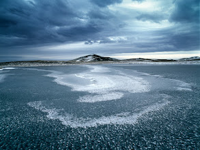 Photo: Near Jokulsarlon, Iceland  I left Jokulsarlon untouched (photographically) this winter, short of any inspiration. It is sometimes a pure imagination that makes me excited about the place I'm heading to that I remember (differently) from my previous visits (and photographs of others). Perhaps, I tend to expect much more than what I'm actually able to see (and photograph) when there.  I left Jokulsarlon disappointed this winter just to find myself exploding (photographically) couple of miles from there. Underneath the heavy skies signaling the snow storm approaching, amongst black sand dunes powdered by snow, I balanced on thin ice of ever-present ponds looking for the structures, patterns and schemas. Realizing (again) that the less is often more, sometimes much more. Appreciating that the (photographical) beauty is so subtle and (many times) well hidden.  Enjoy!